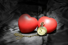 Vintage clock and red heart on black background ,Love and time concept in still life photography. stock images