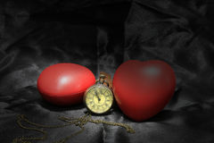Vintage clock and red heart on black background ,Love and time concept in still life photography. stock photo