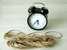 Vintage clock and rope on table. Royalty Free Stock Photography