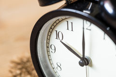 Vintage clock selective focus at number 10 o`clock Stock Image