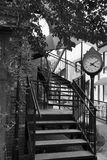 Vintage Clock and Spiral Stairs in Black and White. On downtown street stock image