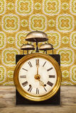 Vintage clock with three bells on top Stock Photo