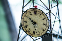 Vintage clock. A vintage clock use for decorated in the vintage coffee shop in Chiangmai, Thailand Stock Photos