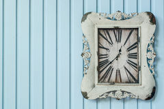 Vintage clock on the wall Stock Photo