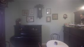 Vintage Clock On Wall. Mistery Foggy Vintage Room with Old Clock On Wall and Piano stock footage
