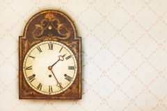 Vintage Clock On A Wall With Retro Wallpaper Royalty Free Stock Photography
