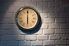 Vintage clock on a white brick wall. At 6:00 Royalty Free Stock Photos