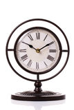 Vintage clock on the white surface background Stock Photos