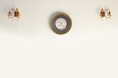 Vintage clock on a white wall royalty free stock image