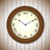 Vintage clock on wooden background Stock Photo