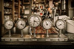Vintage clocks. On a bar counter in a pub Royalty Free Stock Images