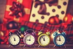 Vintage clocks on christmas background. Royalty Free Stock Image