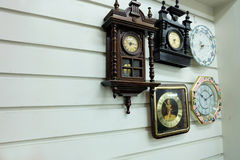 Vintage Clocks, Different Styles Old Clocks on Vintage Wall Background Background. Great For Any Use stock photography