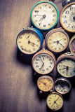 Vintage clocks in pile Royalty Free Stock Image