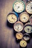 Vintage clocks in pile. Closeup of vintage clocks in pile Royalty Free Stock Image