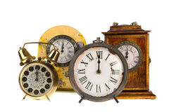 Vintage clocks at twelve. All vintage clocks at twelve hours isolated over white royalty free stock photo