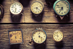 Vintage clocks on the wall. Closeup of vintage clocks on the wall royalty free stock images