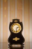 Vintage clocks on wallpaper background Stock Image
