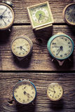 Vintage clocks on the wooden wall. Closeup of vintage clocks on the wooden wall stock photography