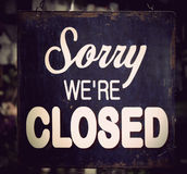 Vintage closed sign. Vintage metal closed sign on shop door Stock Photo
