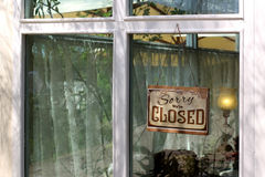 Vintage closed sign. Hanging in front of shop window Royalty Free Stock Photography