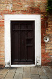 Vintage closed wooden door, Venice, Italy Royalty Free Stock Image