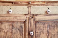 Vintage closet. Vintage, fragment of the old-time closet after restoration, doors and boxes royalty free stock photos