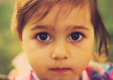 Vintage closeup portrait of Cute sad kid with big eyes. Closeup portrait of Cute sad kid with big eyes Royalty Free Stock Photo
