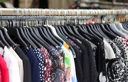 Vintage clothes for sale at  flea market Royalty Free Stock Images