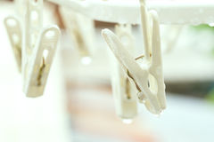 Vintage clothespin on rainyday with selective focus on peg. Vintage color adjustment royalty free stock photo