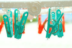 Vintage clothespin on rainyday with selective focus on peg. Vintage color adjustment royalty free stock photos