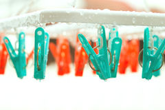 Vintage clothespin on rainyday with selective focus on peg. Vintage color adjustment stock photo