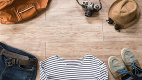 Vintage clothing and accessories on the wooden background Royalty Free Stock Image