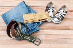 Vintage cloths and accessories on a wooden background Stock Image