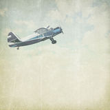 Vintage cloudy background with plane Royalty Free Stock Image