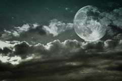 Vintage cloudy sky with full moon. Copy space. Stock Images