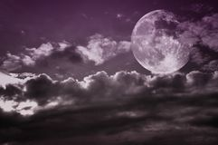Vintage cloudy sky with full moon. Copy space. Vintage cloudy sky with full moon. Moon image courtesy NASA Stock Image