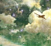 Vintage cloudy sky with stars and flying airplane Royalty Free Stock Photos