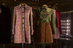 Vintage coats displayed in the window stock images