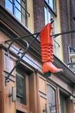 Vintage cobbler shop sign in Amsterdam, Netherlands. Vintage cobbler shop sign with red boot in Amsterdam, Netherlands. selective focus stock image