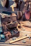 Vintage cobbler workplace with brush and shoes Royalty Free Stock Photography