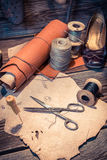 Vintage cobbler workplace with tools, shoes and leather Royalty Free Stock Photos