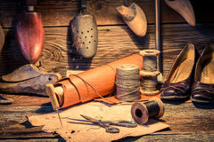 Vintage cobbler workshop with brush and shoes Royalty Free Stock Photography