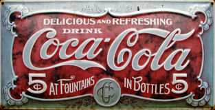 Vintage coca cola advert. Very old metal coca cola adwert Stock Image