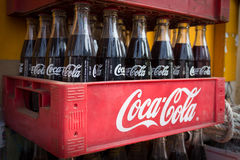 Vintage Coca Cola bottles in red plastic box, Royalty Free Stock Photos