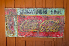 Vintage Coca Cola Sign in Old West Town Royalty Free Stock Photos