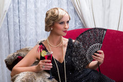 Vintage cocktail and fan Royalty Free Stock Images