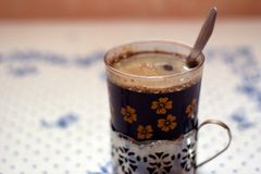 Vintage coffee cup/glass with spoon Royalty Free Stock Photos