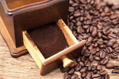 Vintage coffee bean grinder and fresh ground coffee Stock Photos
