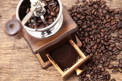 Vintage coffee bean grinder and fresh ground coffee Royalty Free Stock Images